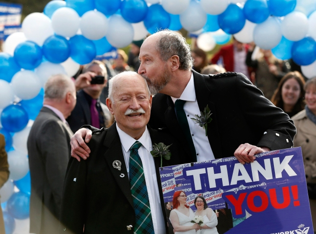 Image: Larry Lamont and Jerry Slater take part in a symbolic same-sex marriage outside the Scottish Parliament in Edinburgh